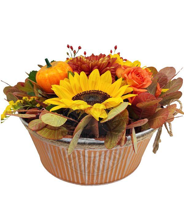 Autumn flower arrangement in metallic pot