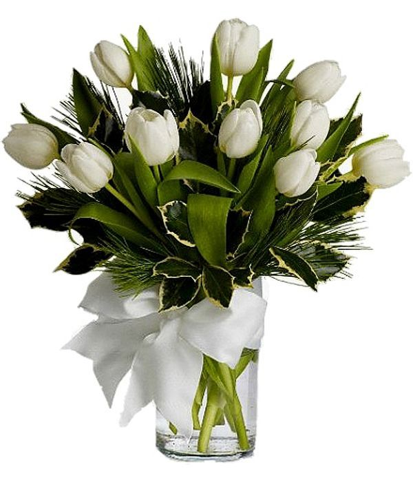 Ten white tulips in a glass vase