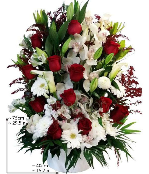 Tall arrangement with red and white flowers