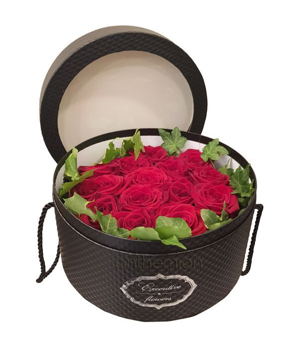 Red roses in round black box