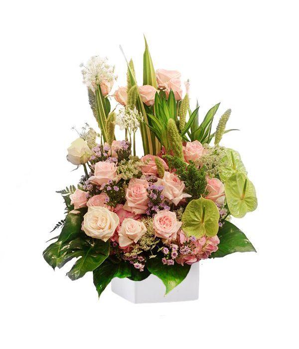 Tall arrangement with hydrangeas and anthurium