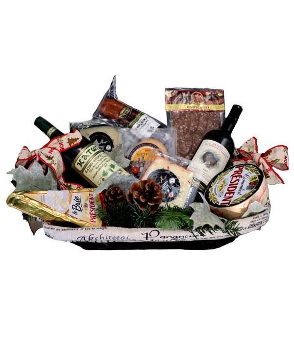 Basket with wine and a variety of cheese and cold cuts