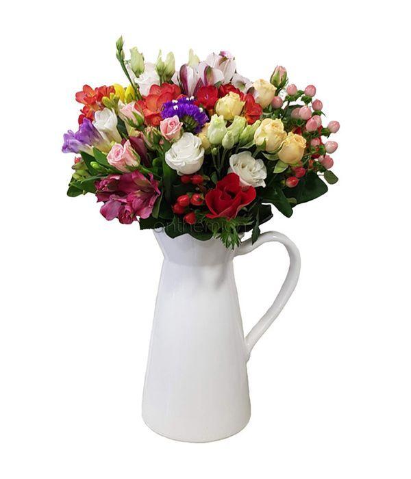 Seasonal bouquet in jug