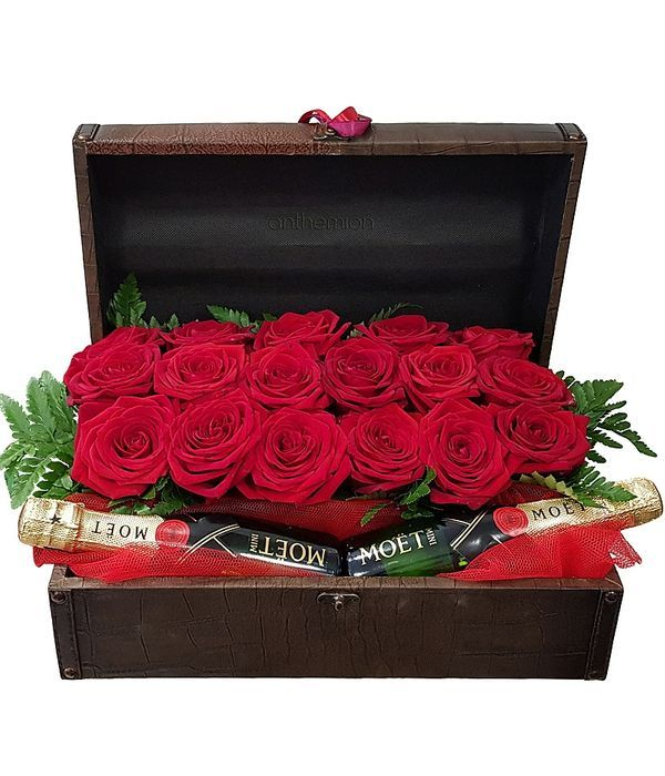 Chest with red roses and two Moet
