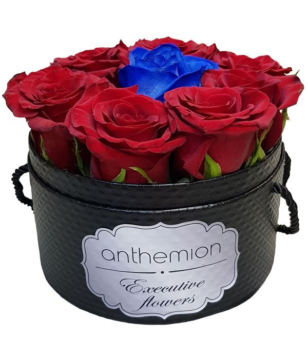 Gorgeous red and blue roses in black box
