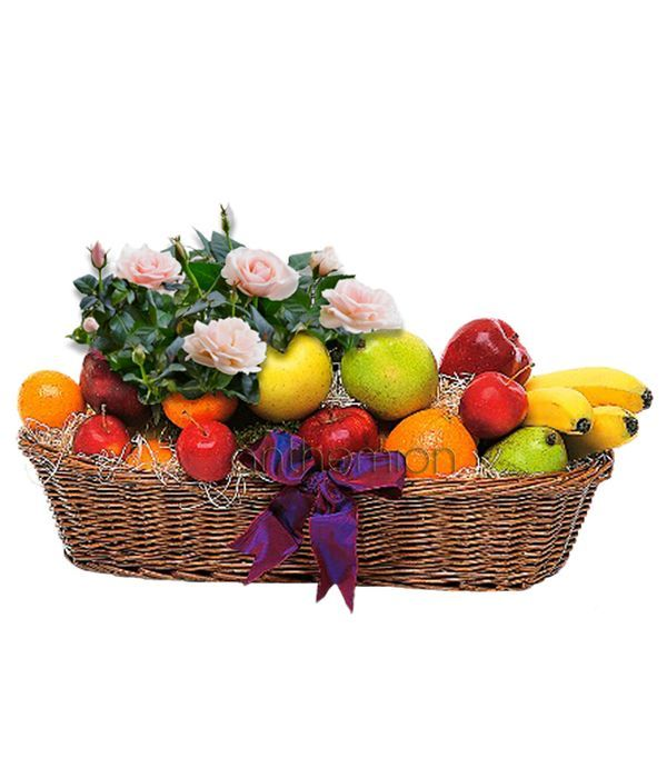 Basket with seasonal plant and fruits