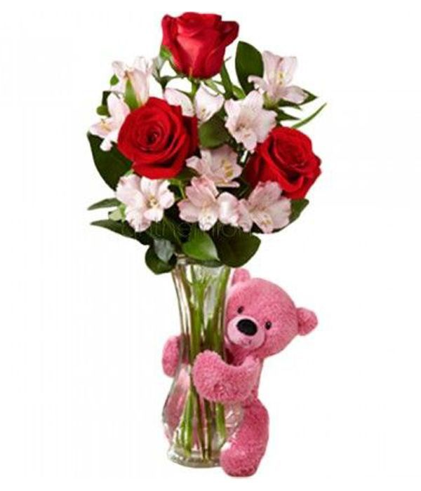 Glass vase with alstromerias, roses and teddy bear