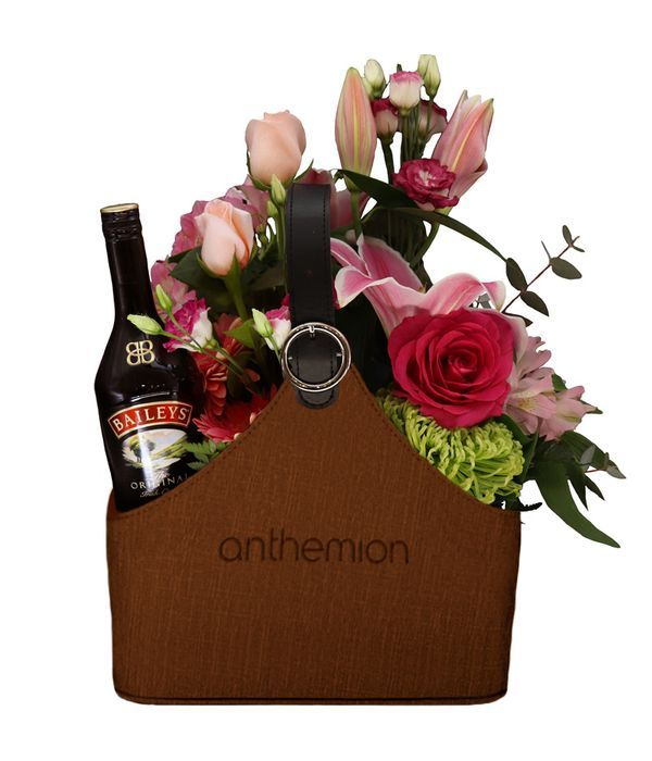 Brown Leather Newspaper case with a Baileys and Flowers