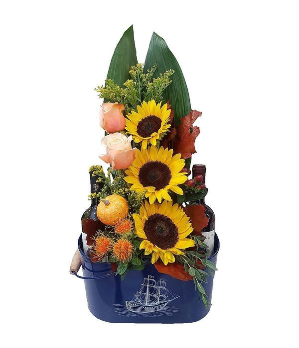 Metallic wine cooler with flowers and two bottles of wine