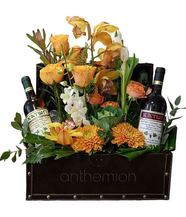 Leather chest with wines and bright flowers