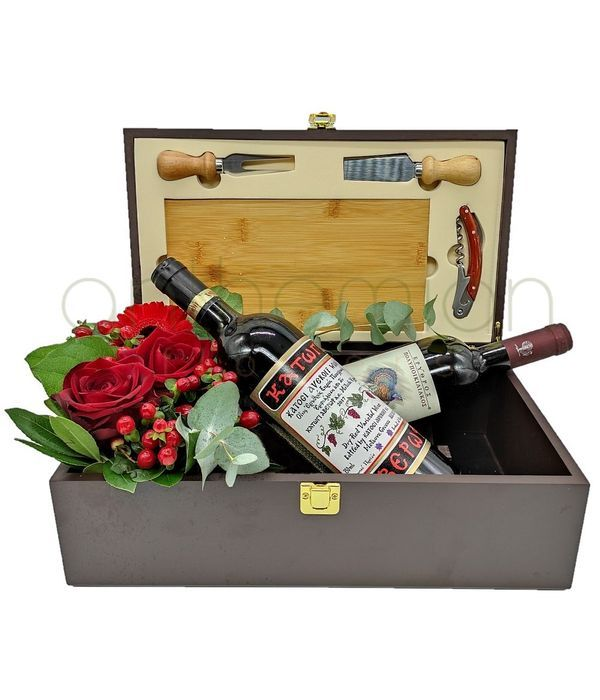 Flowers and wines in a case with cheese accessories