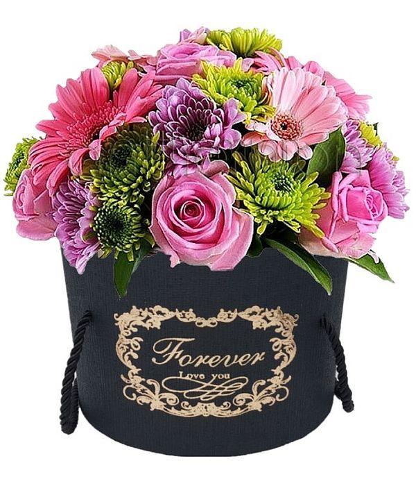 Μαύρο κουτί με πράσινα και ροζ λουλούδια
