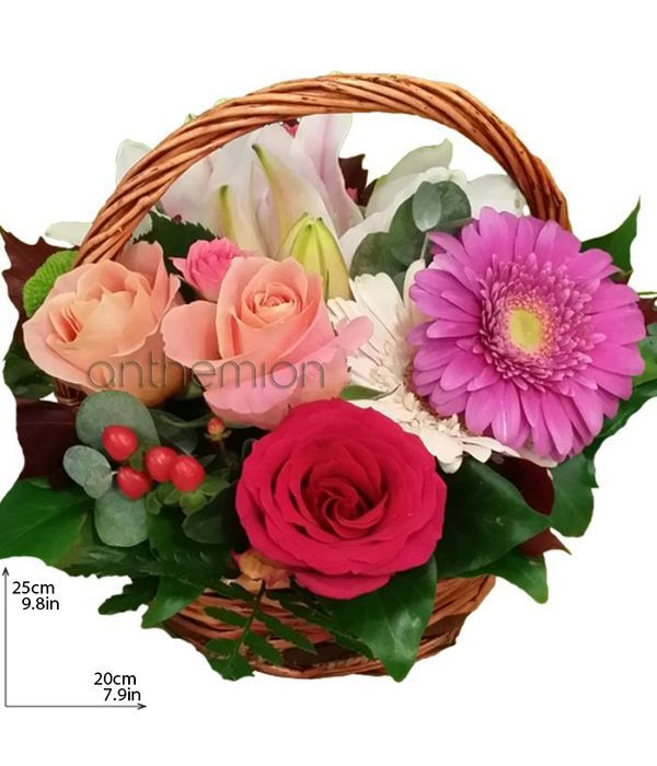 Basket with roses, gerberas and lilies