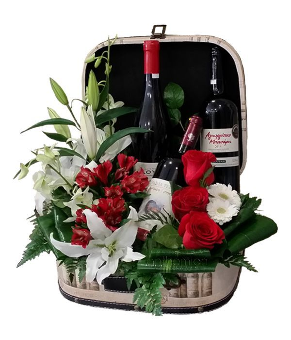Leather suitcase with flowers and wine