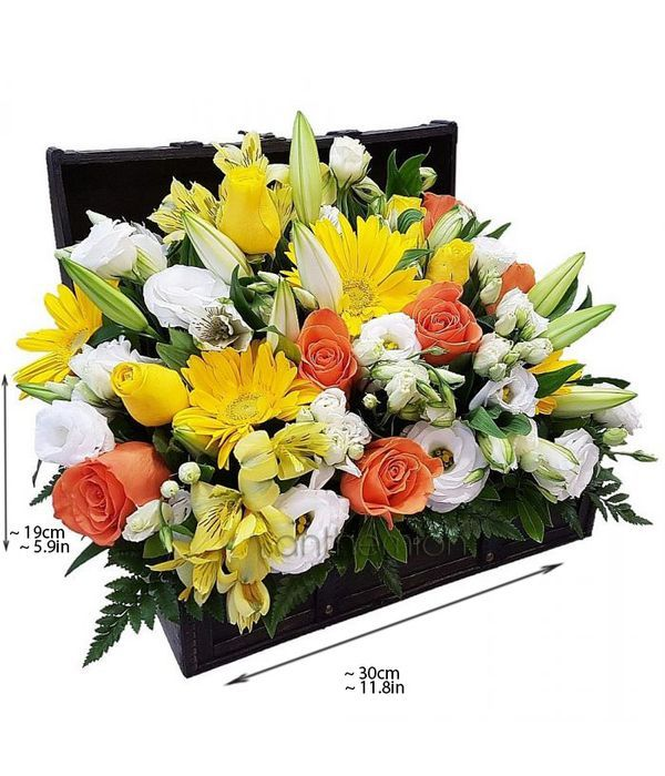 Trunk with orange, white and yellow flowers