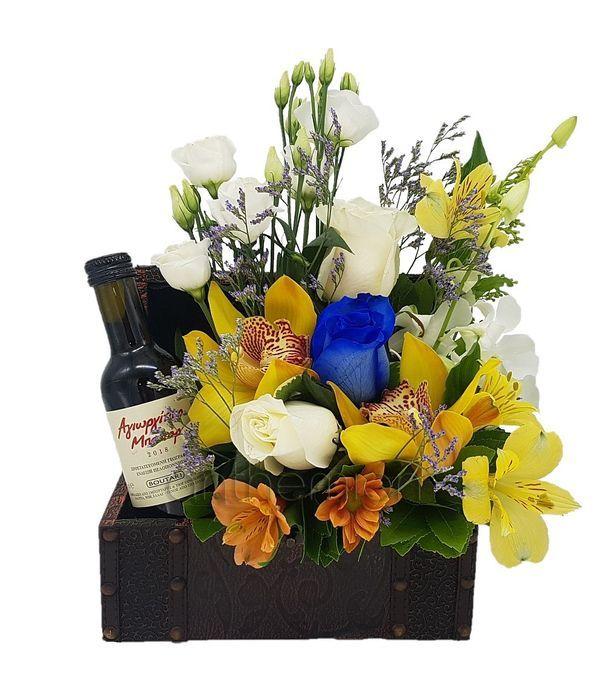 Μπαουλάκι με λουλούδια και κρασί για δώρο