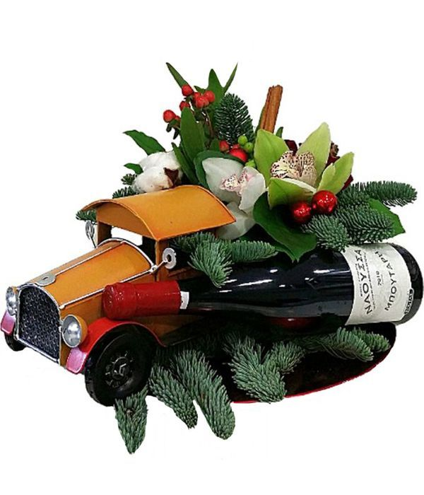 Metallic truck with flowers and red wine