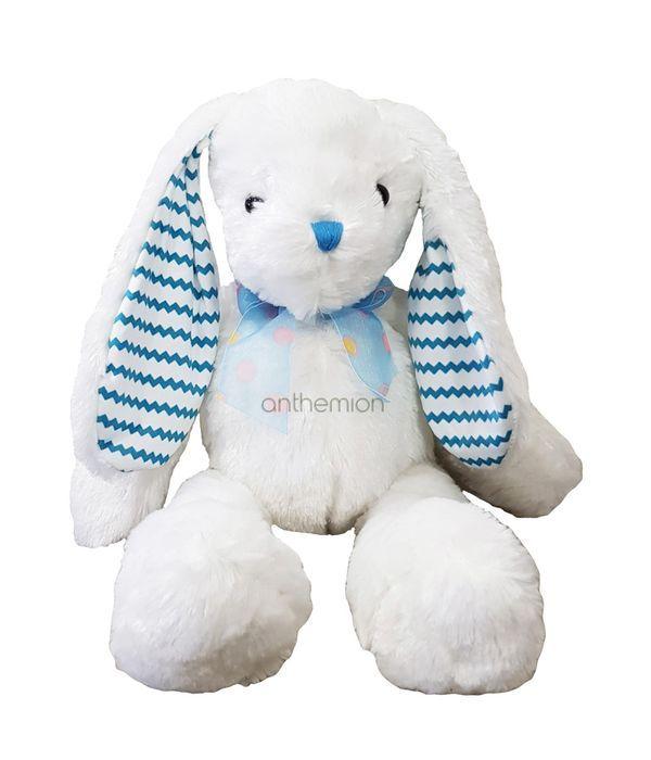 Stuffed bunny with light blue ears