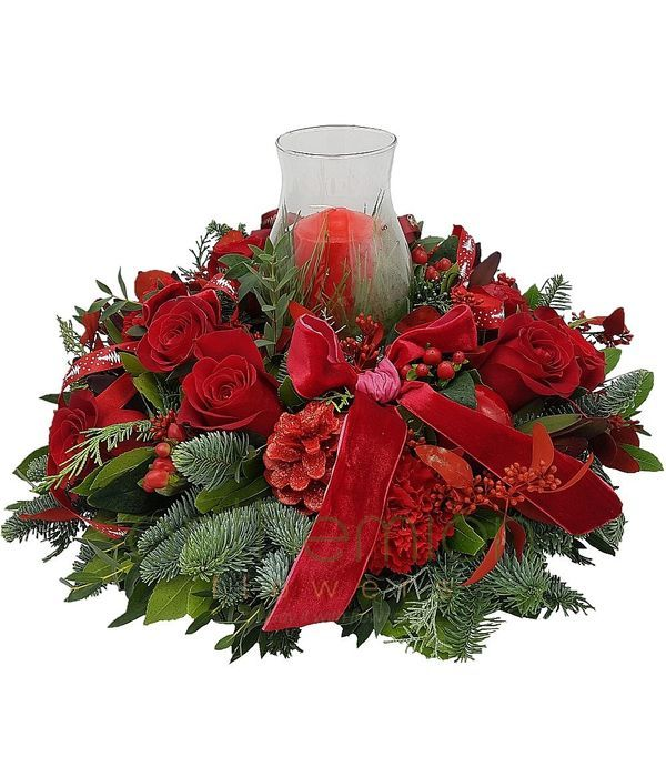 Christmas centerpiece with candle in lamp glass