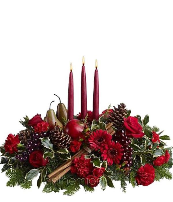 Christmas centerpiece with three candles