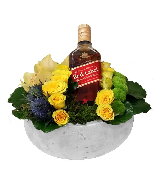 Yellow and green flowers paired with Johnnie Walker