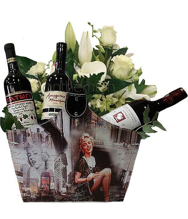 Δερμάτινη τσάντα με τρία κόκκινα κρασιά