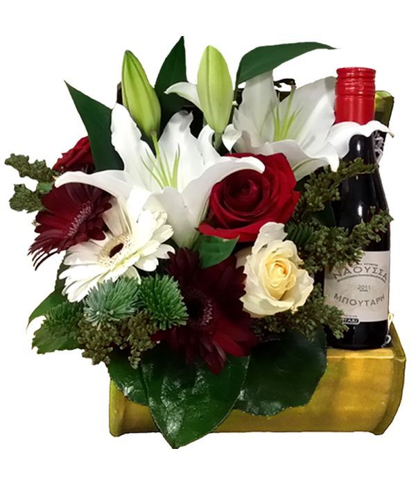 Beautiful arrangement with roses and wine