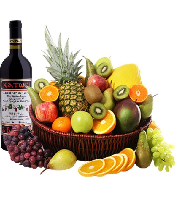 Basket with exotic fruits and red wine