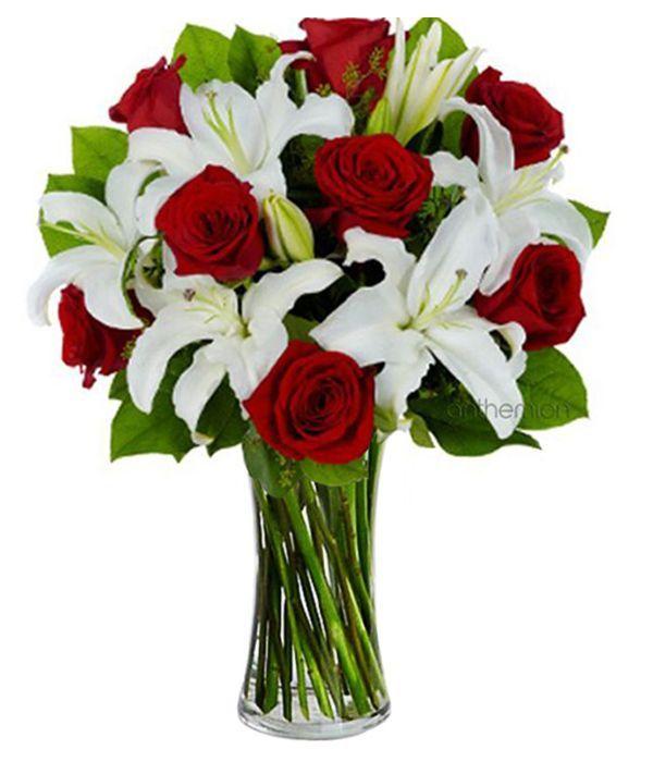 Βouquet of red roses and white lilies