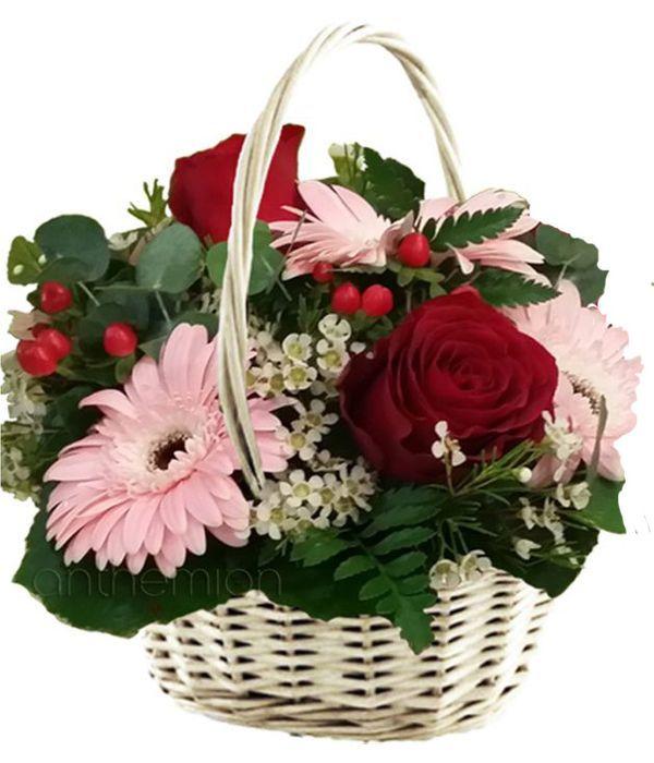 Pink gerberas and red roses in basket
