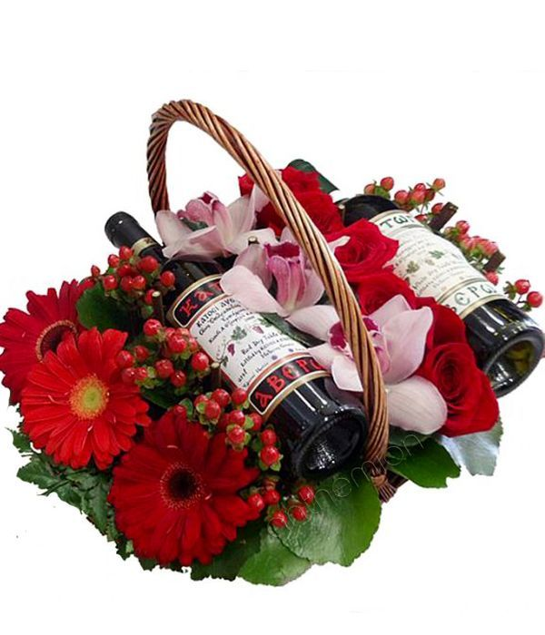 2 wines and flowers in a basket