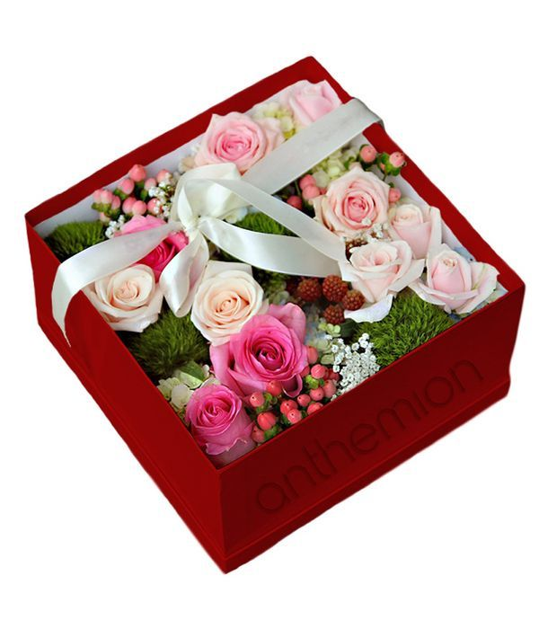 Gorgeous roses with seasonal flowers in square box