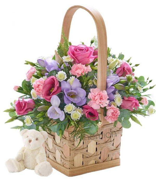 Ροζ και λιλά λουλούδια με αρκουδάκι