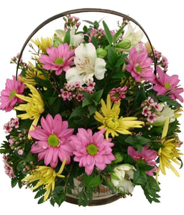 Lilac and yellow flowers in basket