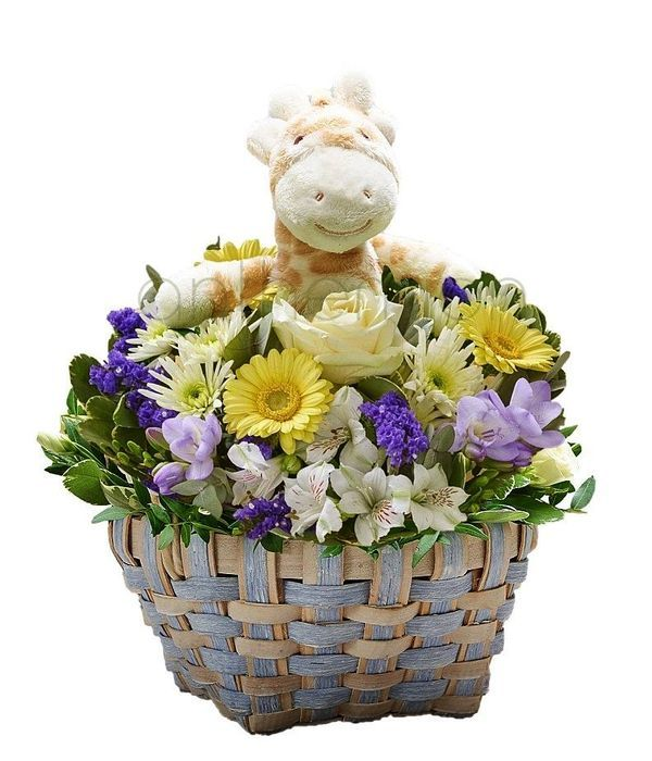 Blue flowers and toy in charming basket