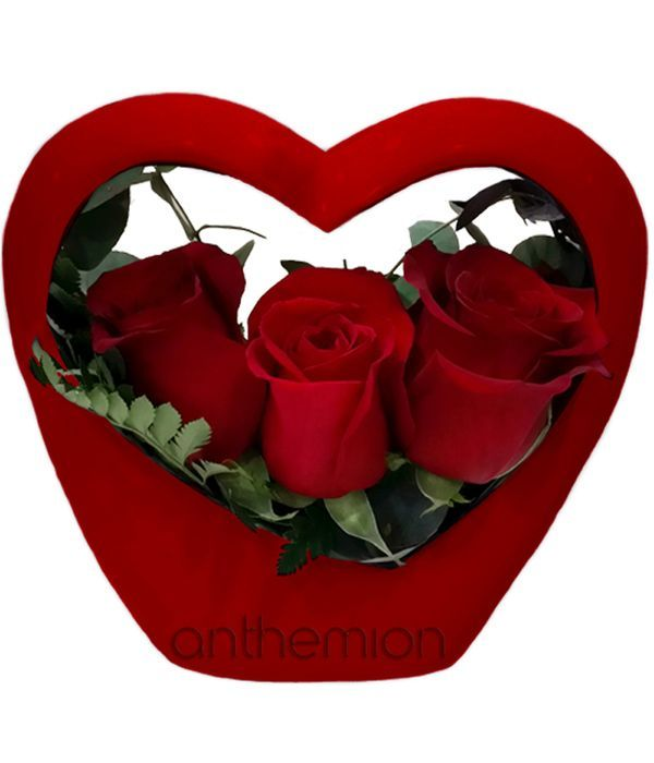 Red roses in heart-shaped container