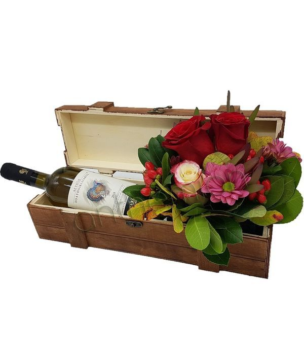 Wooden box with flowers and wine