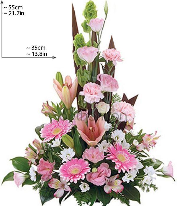 Ψηλή σύνθεση με λευκά και ροζ άνθη