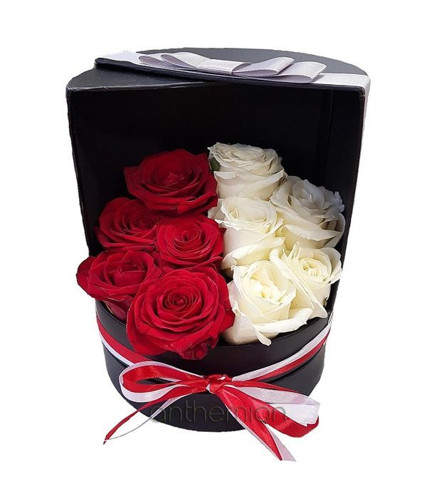 Red and white roses in tall gift box