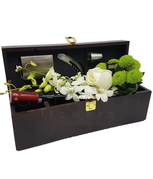 Flowers and wine in a gift box