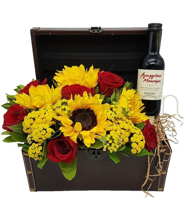 Chest with yellow flowers and red wine