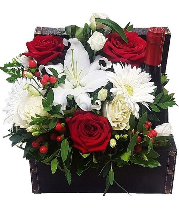 Chest with red/white flowers and wine