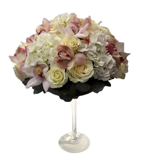 Martini glass with hydrangeas, roses, orchids