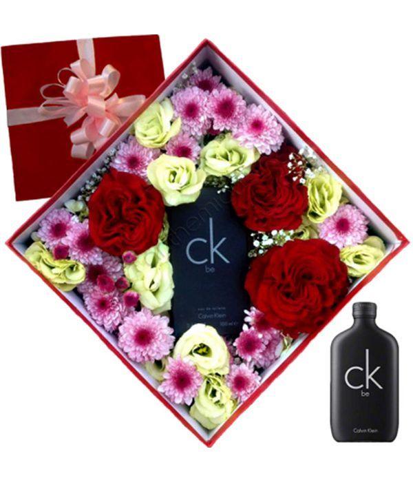 Σύνθεση με λουλούδια και Calvin Klein BE for him