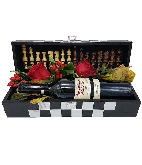 Chess board with flowers and wine