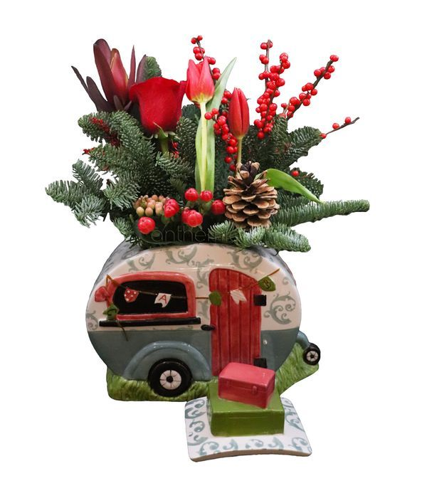 Χριστουγεννιάτικο τροχόσπιτο με λουλούδια